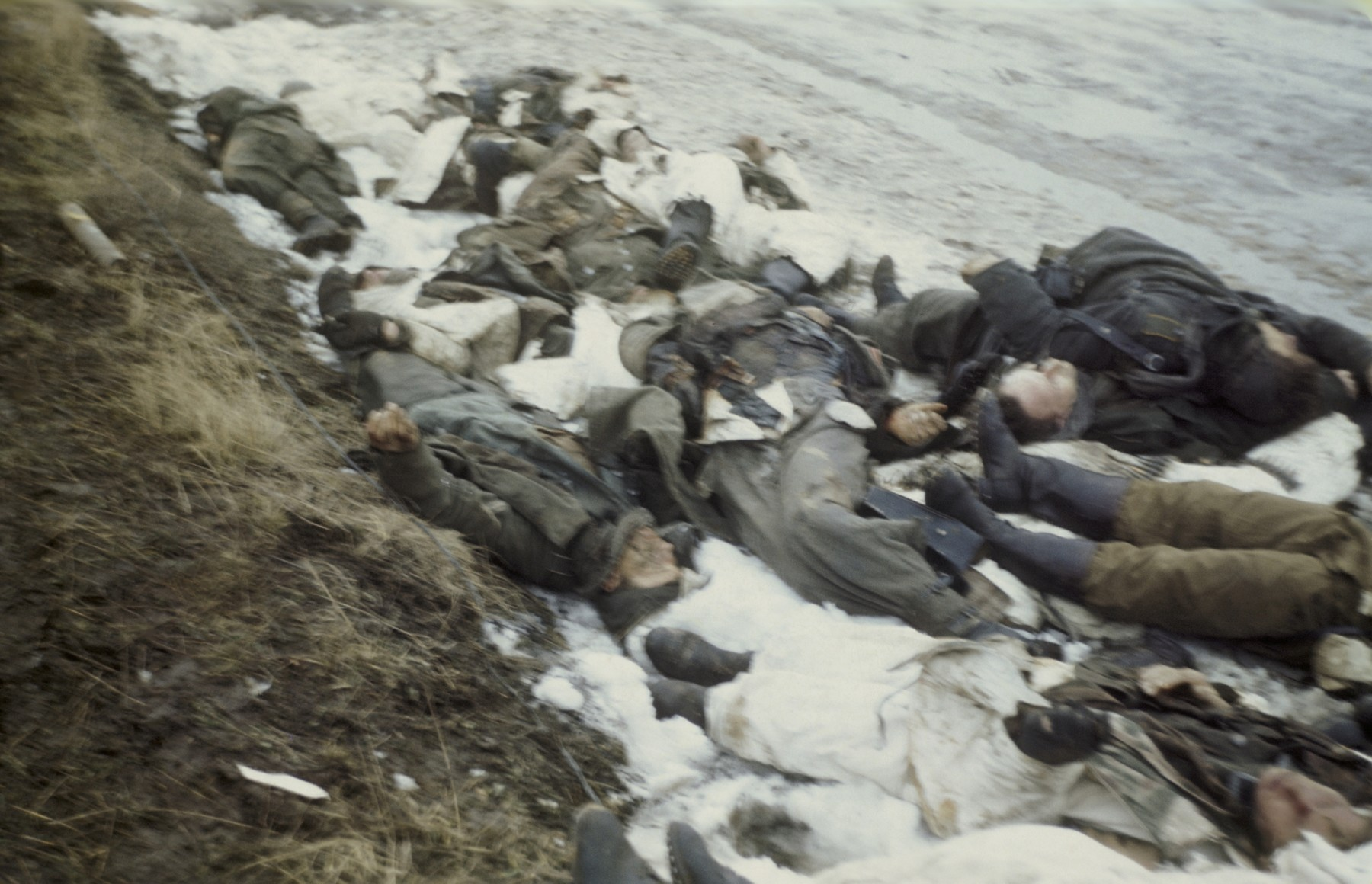 The snow covered bodies [probably of executed SS guards] in the newly liberated Dachau concentration camp.