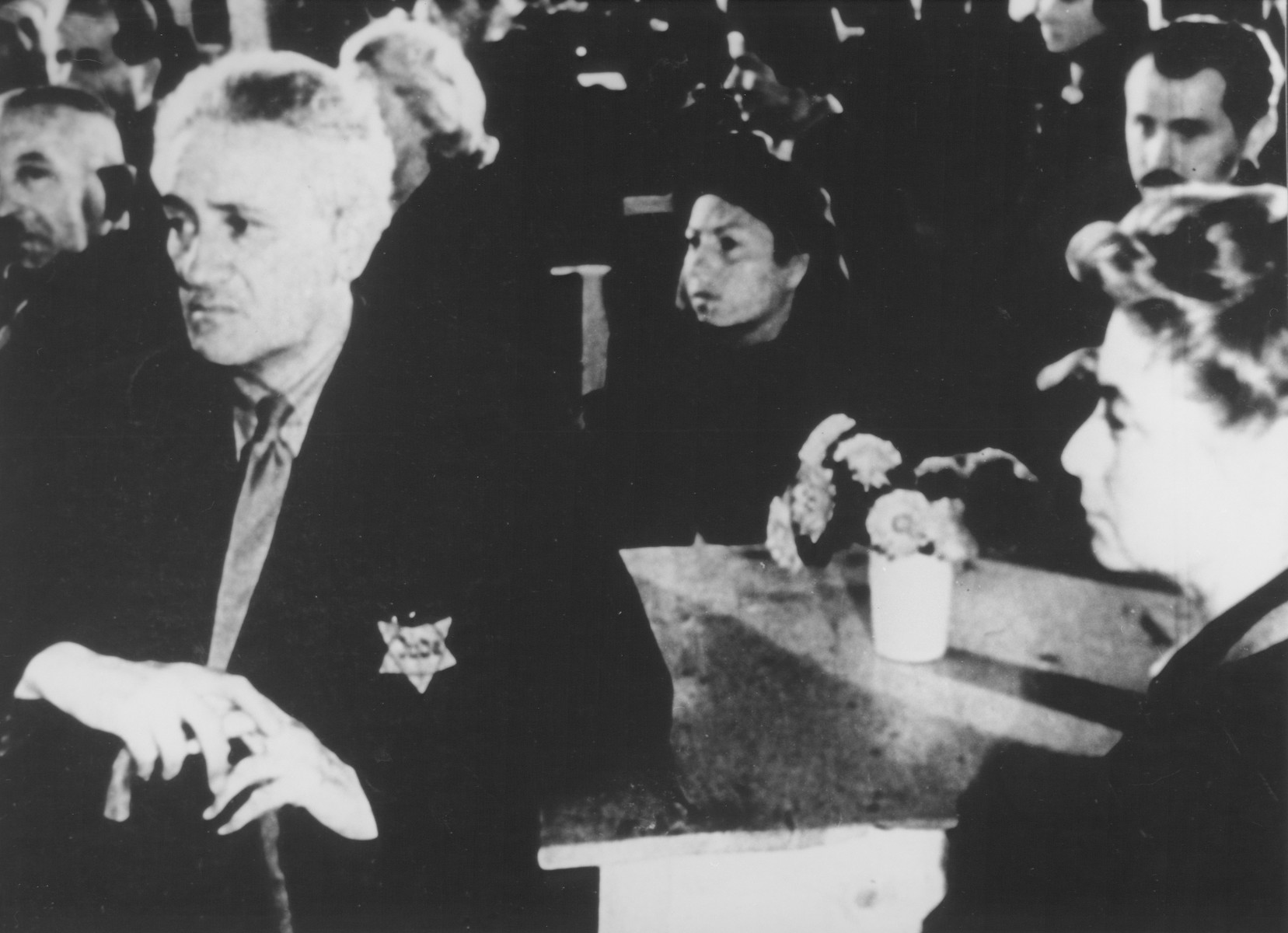 "STILL PHOTOGRAPH FROM THE NAZI PROPAGANDA FILM, ""Der Fuehrer Schenkt den Juden eine Stadt"" [The Fuehrer gives the Jews a City].  Jews watching a performance in the Theresienstadt ghetto.  Among those pictured are Morits Oppenheim (left) and Melanie Oppenhejm.  They were deported from Copenhagen on October 13, 1943."