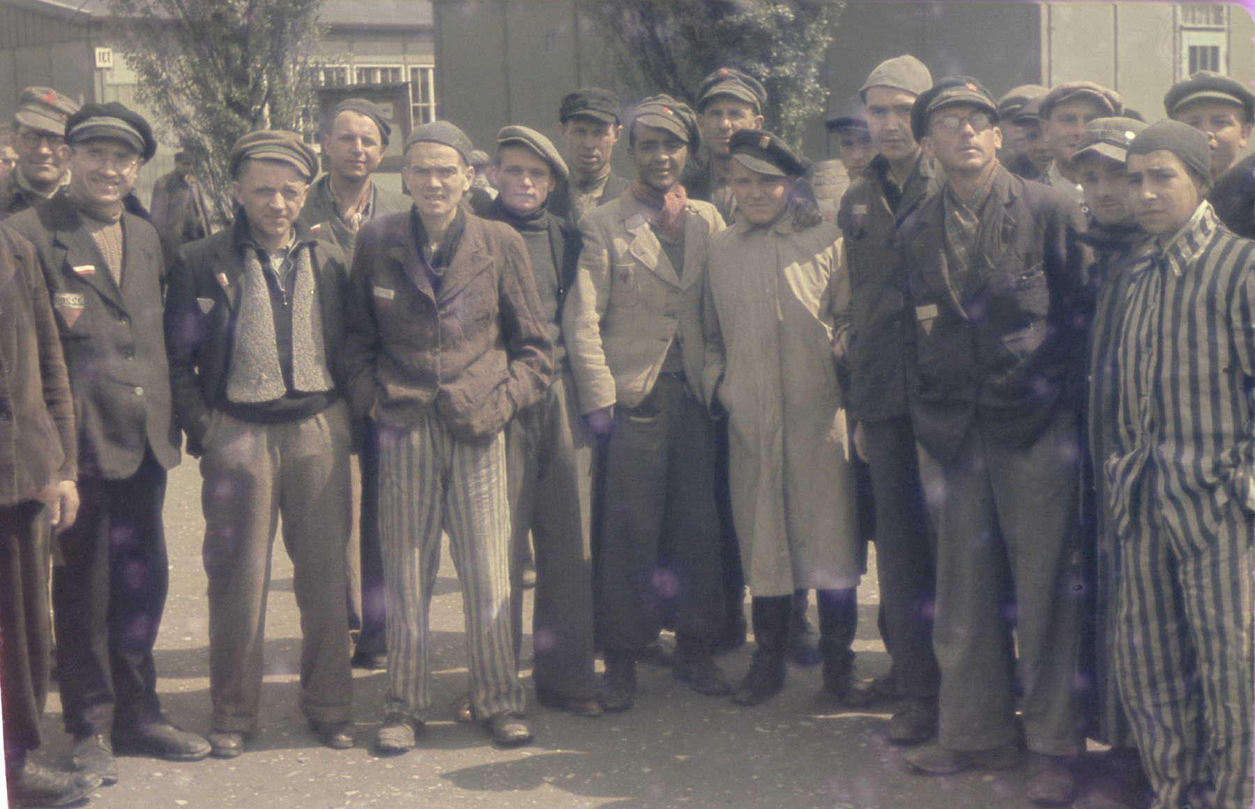 Group portrait of former political prisoners in the newly liberated Dachau concentration camp.
