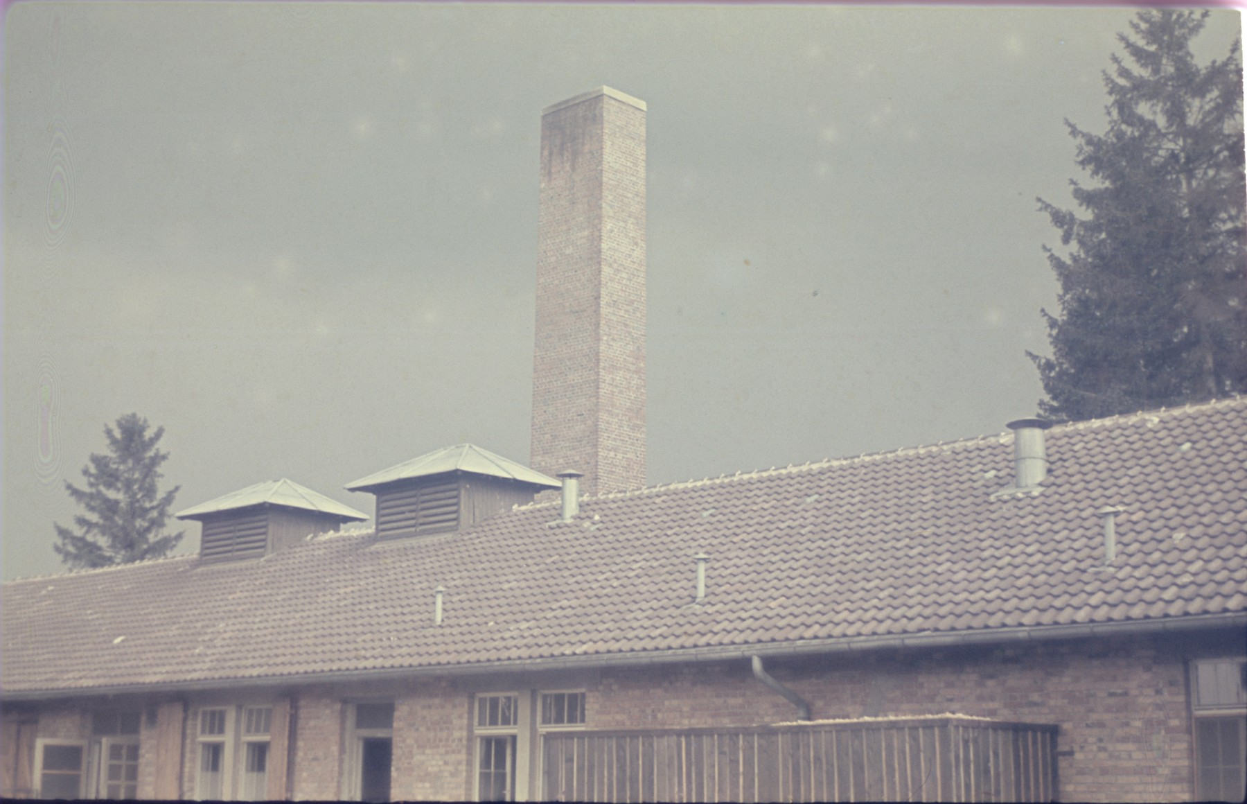 Partial view of the crematorium, focusing on the chimney, in the newly liberated Dachau concentration camp.