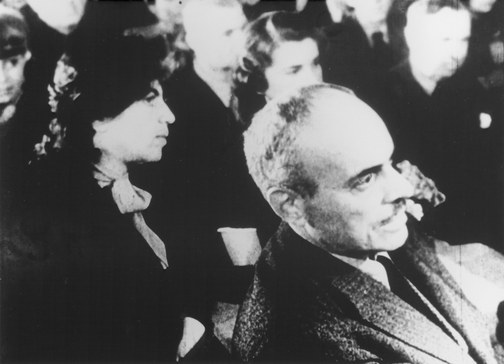 """STILL PHOTOGRAPH FROM THE NAZI PROPAGANDA FILM, """"Der Fuehrer Schenkt den Juden eine Stadt"""" [The Fuehrer gives the Jews a City].  Jewish prisoners sitting in an audience in the Theresienstadt ghetto."""