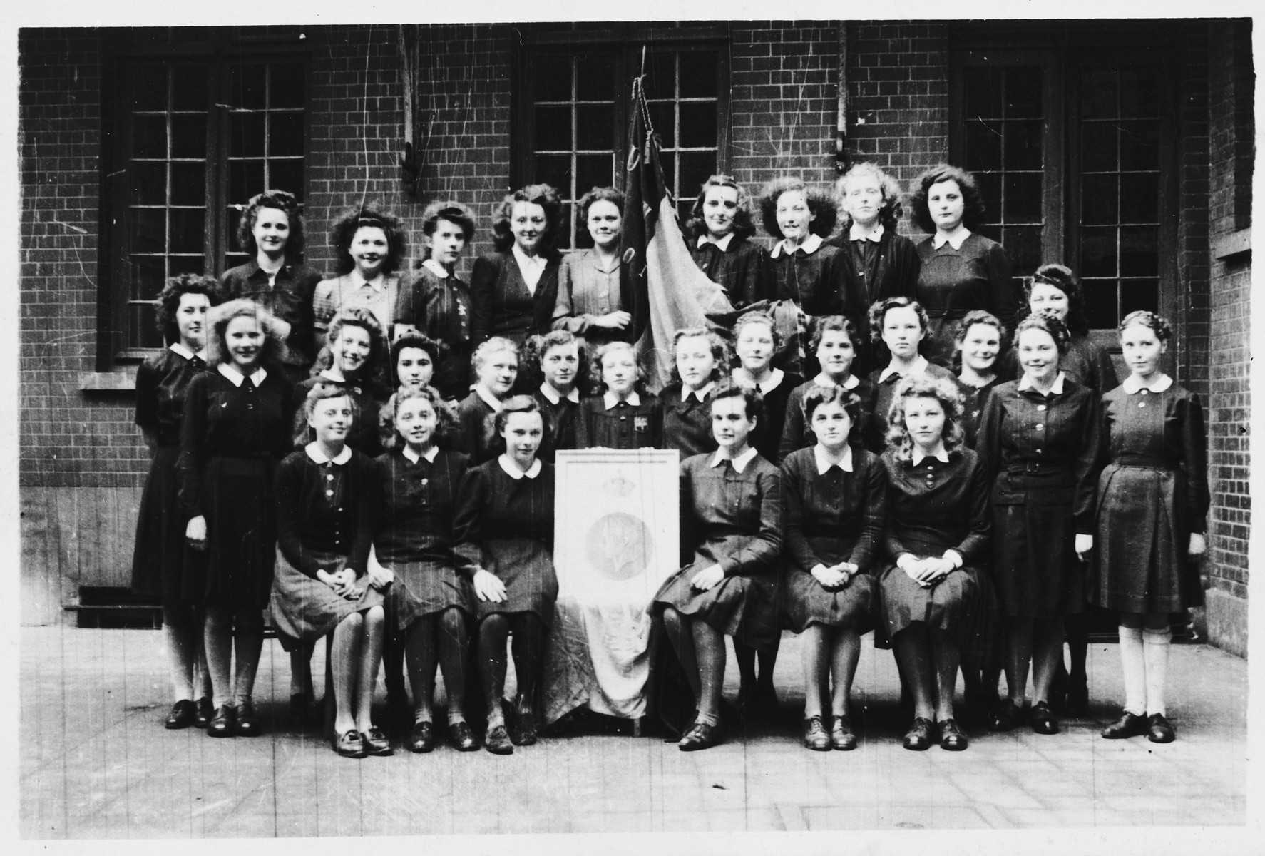 Group portrait of students at Les Soeurs de Notre Dame convent school.  Hena Kohn is pictured in the top row, second from the left.