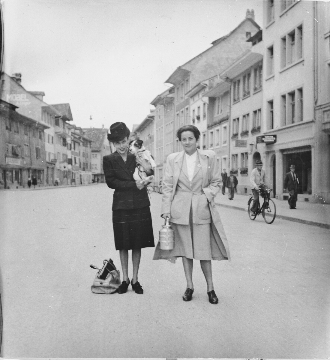 Frieda Belinfante (right) poses with a friend on the Steinbergasse, a historic street in Winterthur, Switzerland.  The photograph was taken shortly after she was allowed to leave the refugee camp Hotel Pellerin.