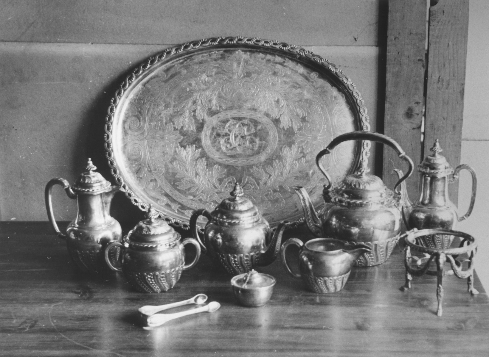 Display of a silver coffee set, confiscated from a Jewish household.