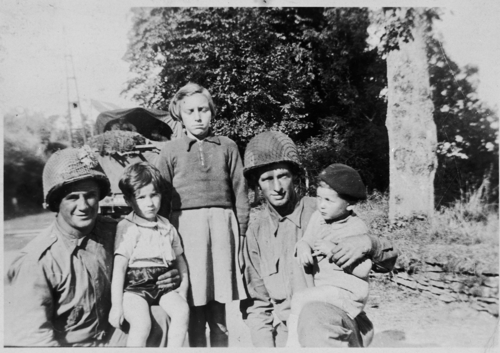 Belgian children pose with American soldiers in Brussels.  Pictured on the right is Hena's cousin Marcel Shumiliver.