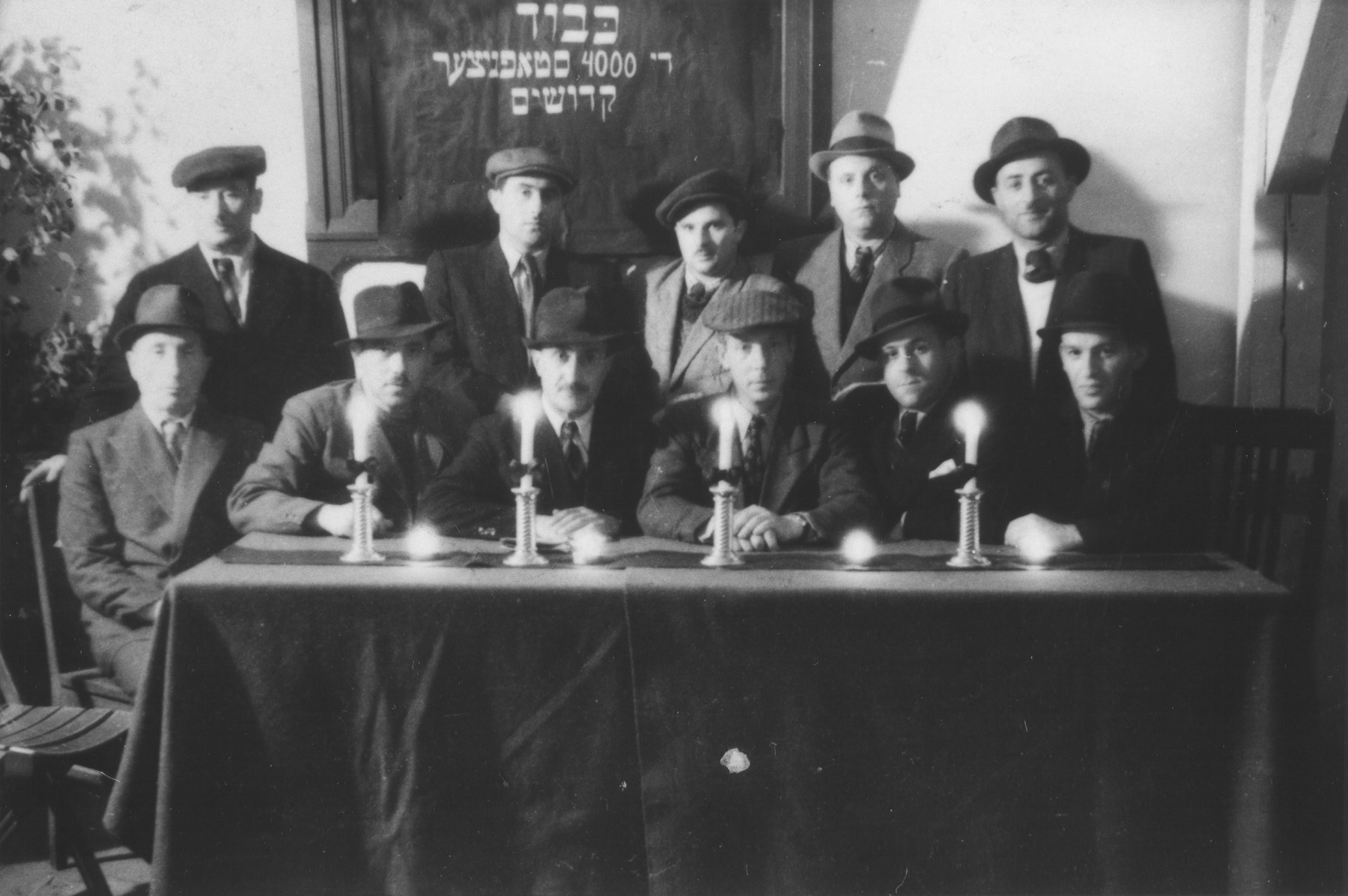 Memorial service in memory of the 4000 Jews from Stopnice killed in the Holocaust.  Among those pictured is Yidl Michaelowski (standing on the far left) and Mordechai Silberberg (center).