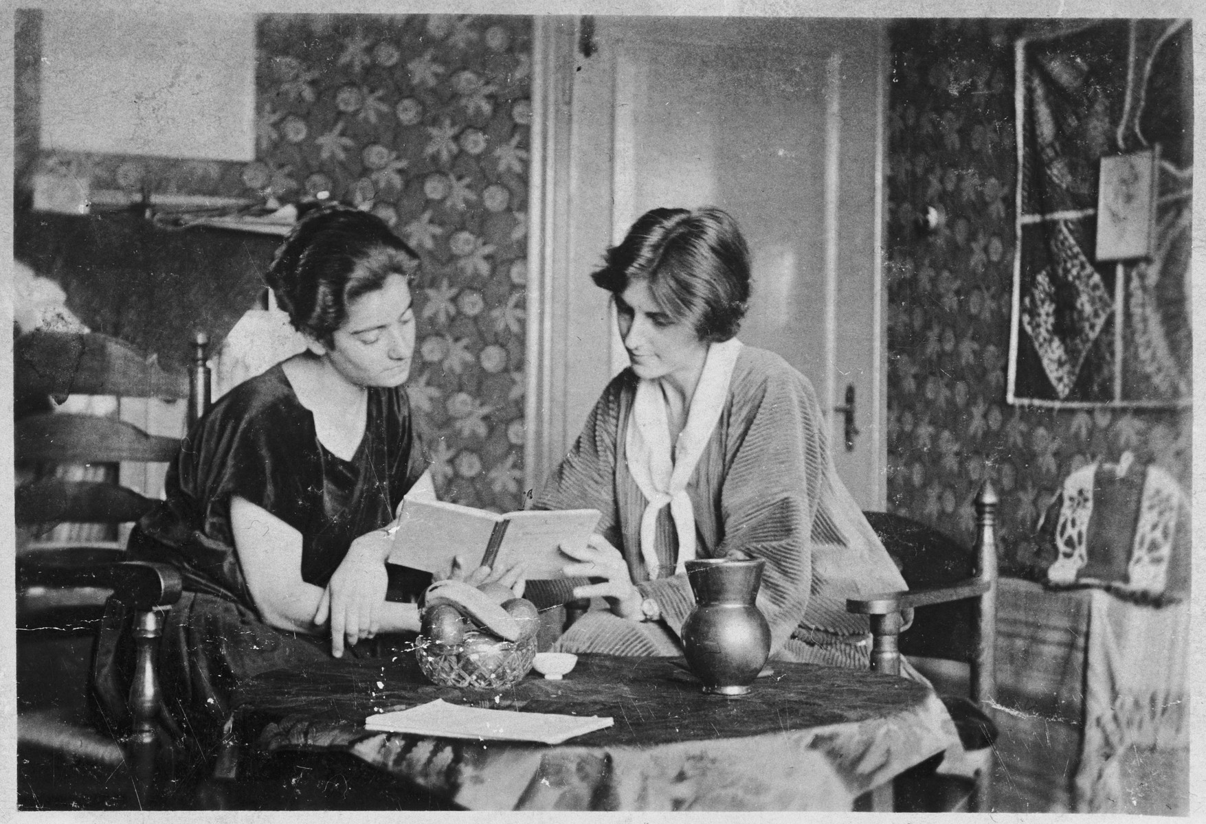 Frieda Belinfante sits at a table with her partner in their home at Hendrik Jacobszstraat in Amsterdam.   Henriette Bosmans, a well-known composer and pianist, was the partner of Frieda Belinfante for seven years.