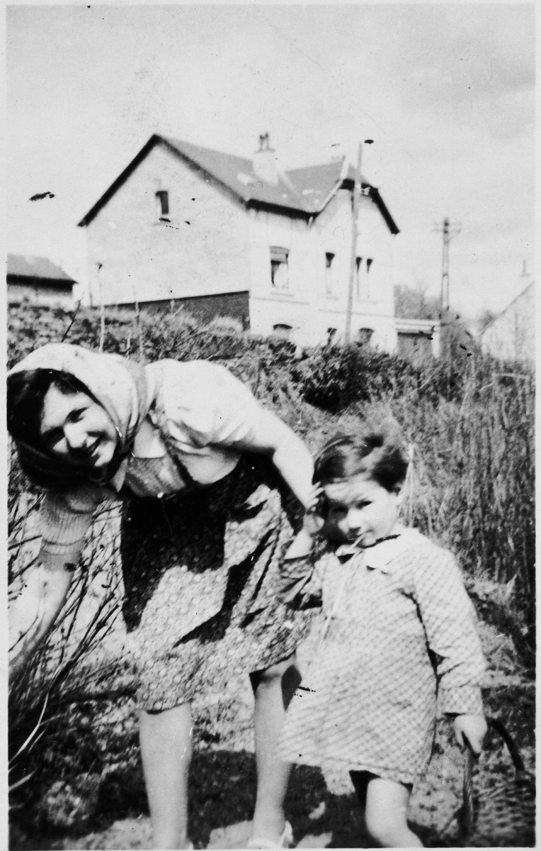 Hena Kohn poses with her younger cousin Marcel Shumiliver while hiding at the home of Belgian rescuer Alix Robert.