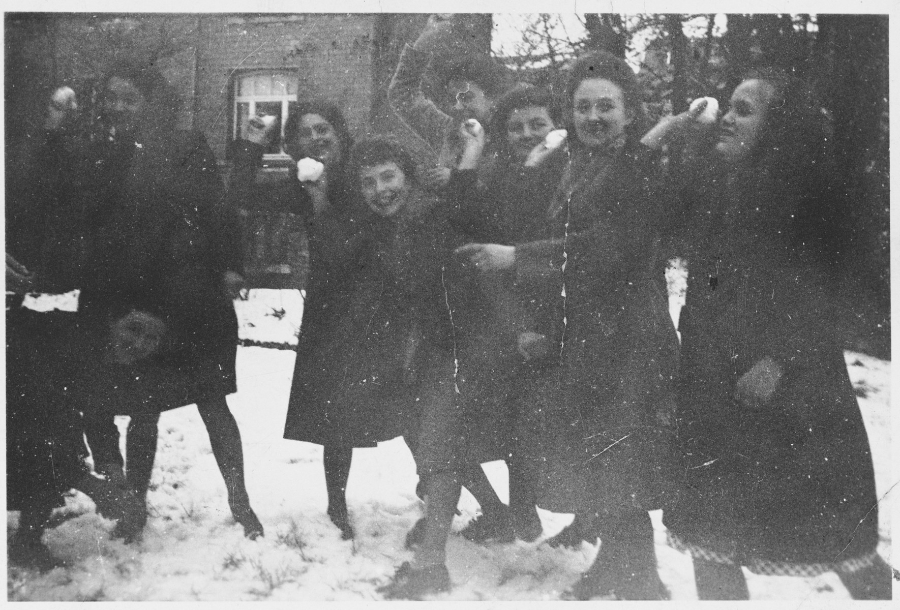 A group of Jewish girls who are living in hiding in Belgium, play in the snow.
