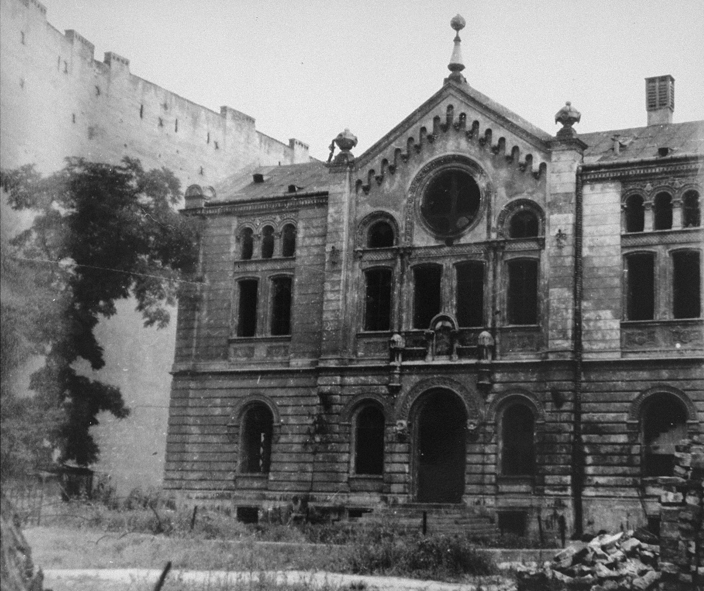 The Nozyk Synagogue in Warsaw.  The synagogue was damaged by an air raid in September 1939. During the war, it was contained within the Small Ghetto area.  After the Warsaw ghetto uprising and the deportation of the Jewish population, it was used by the Germans as a stable and depot.