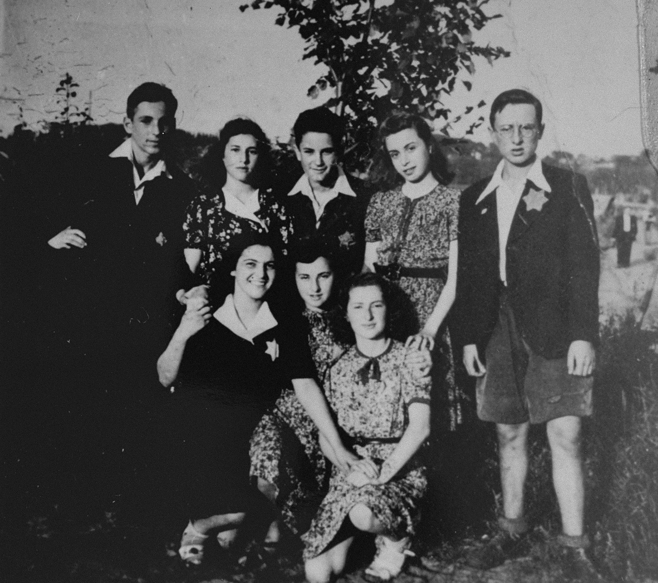 Members of the Irgun Brit Zion Zionist youth movement in the Kovno ghetto.  Standing from left to right are:  Avraham Gurwitz; Miriam Rogol (now Pfeffer); Moshe (Avraham?) Nadel; Lea Sokolsky; Aharon Rozin.  Kneeling from left to right are: Mina Kaminsky (now Shafir); Rivka Rogol; Ester Gottfarstein.