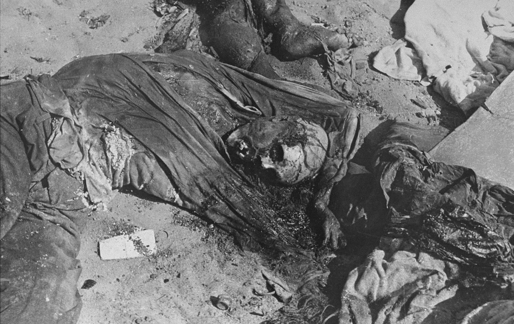 The charred corpses of Rabbi Shmukliarski, his wife and son in their bunker after the razing of the Kovno ghetto.