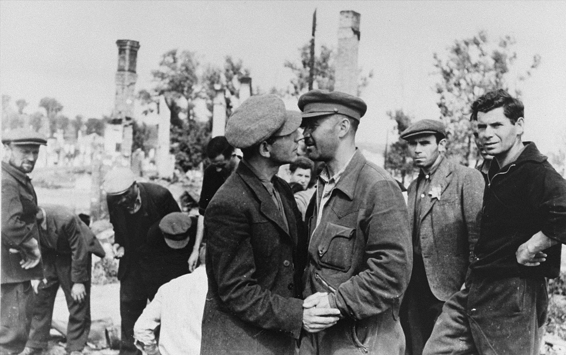 Kovno ghetto survivors greet one another amid the ruins of the ghetto.    Jona Wisgardisky is pictured second from the right.