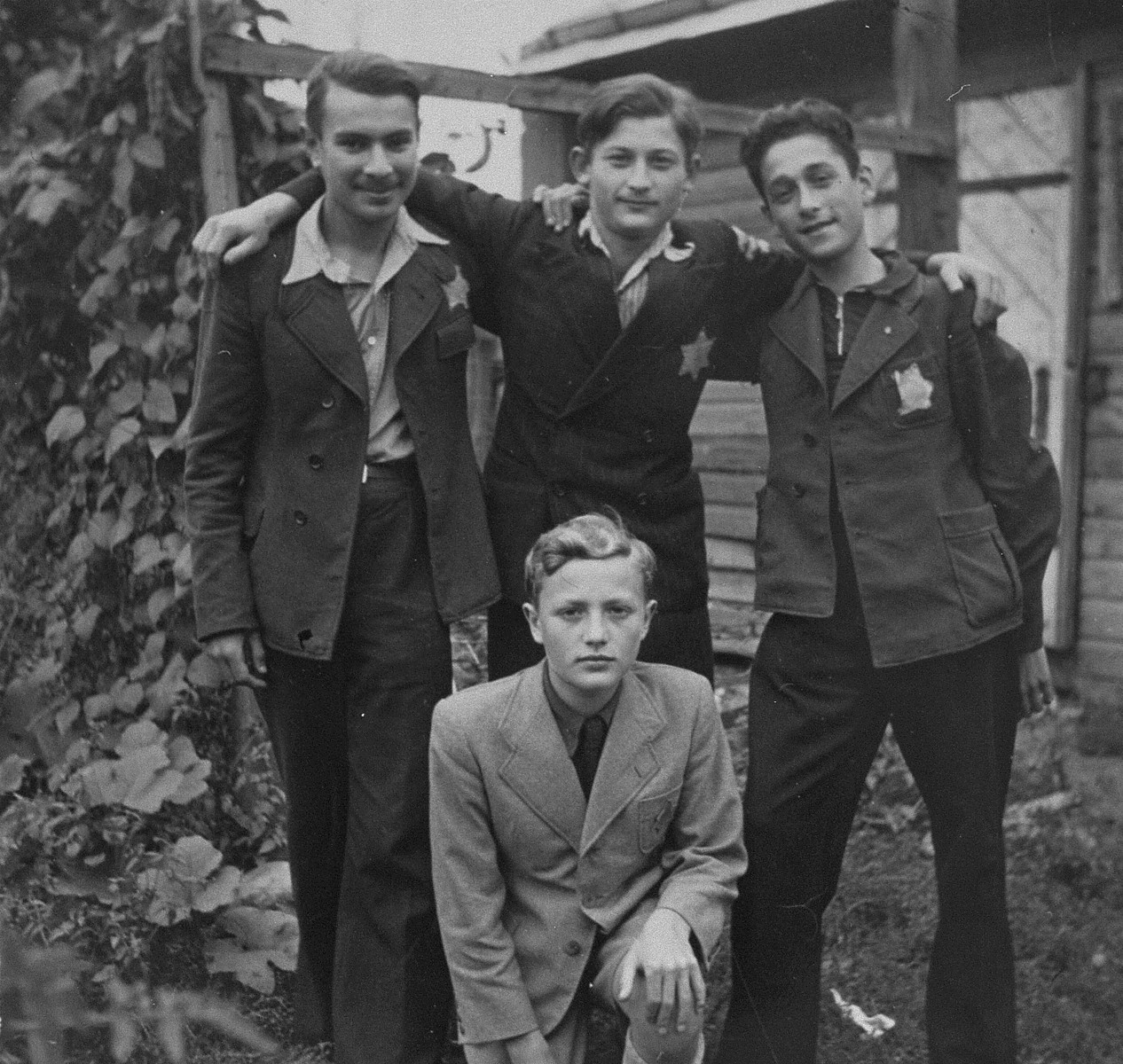 Group portrait of members of Irgun Brit Zion in the Kovno ghetto.  Among those pictured are:  Zalman Kravitz (standing at the left); Shalom Yadkowsky (standing at the right); and Bobi Blumberg (sitting in front).  Kravitz was killed during the last German action in the ghetto; Yadkowsky died in Dachau; and Blumberg survived.