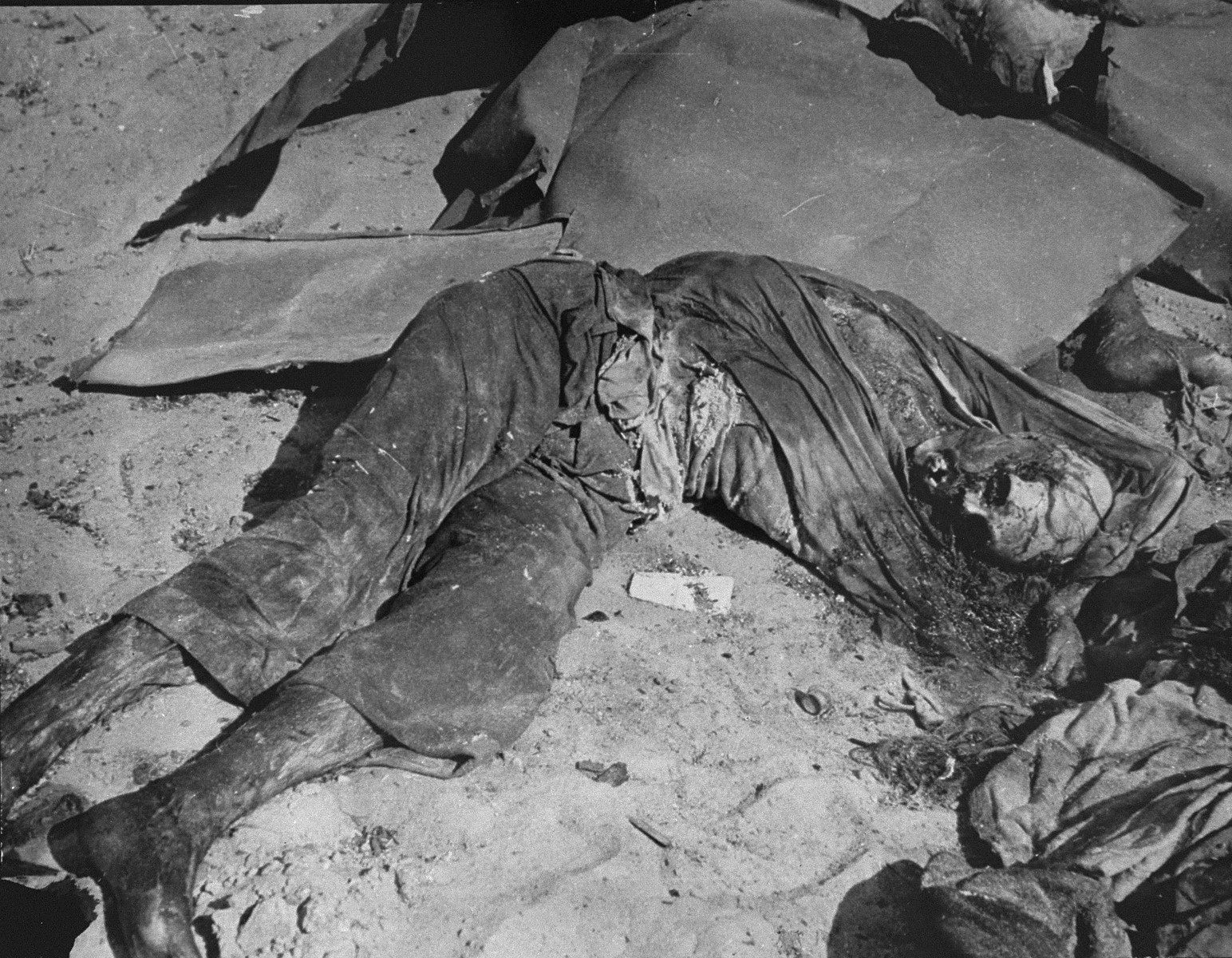 The charred corpse of Rabbi Shmukliarski in his bunker after the razing of the Kovno ghetto.