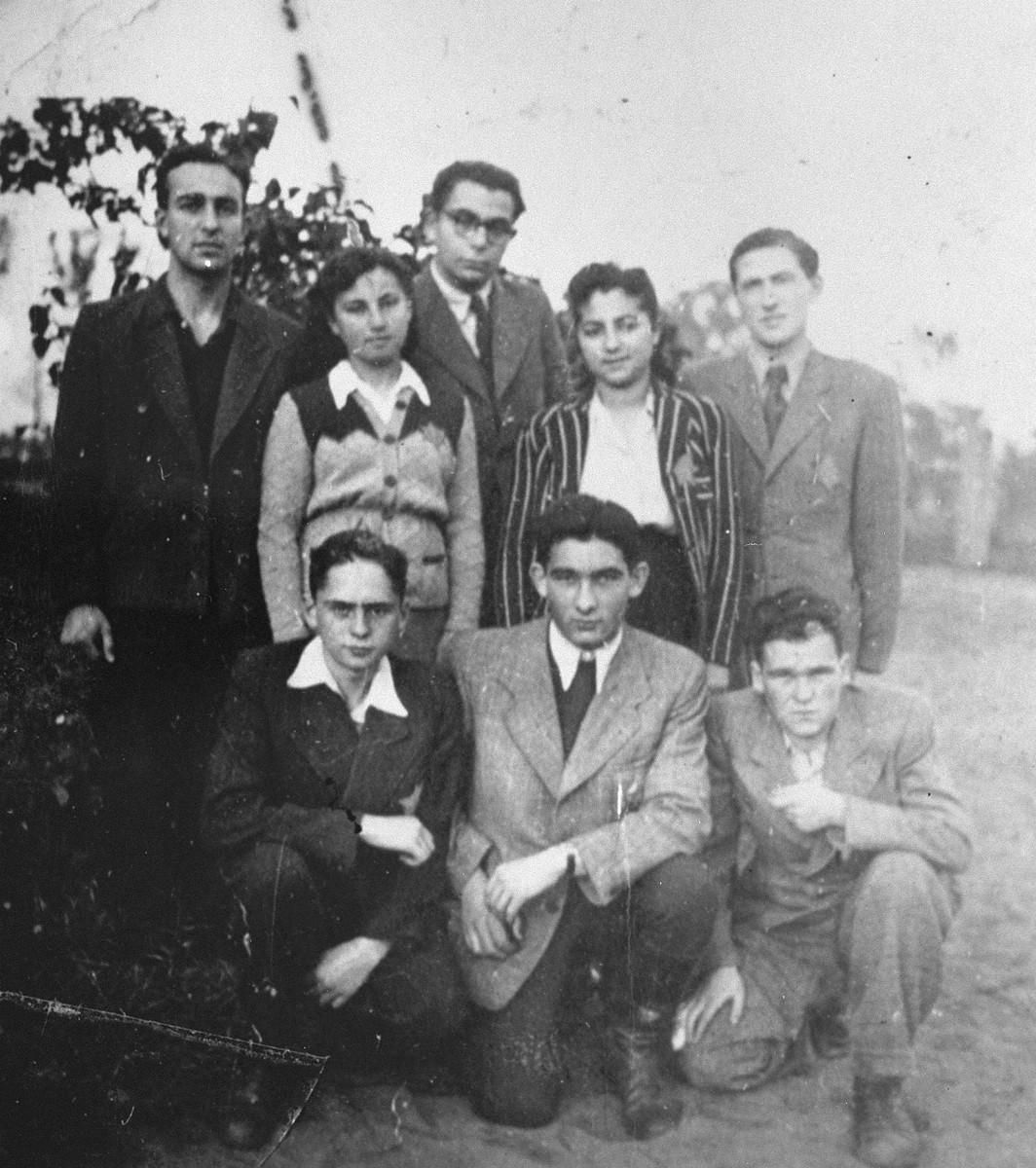 Members of the Irgun Brit Zion Zionist youth movement in the Kovno ghetto.  Standing from left to right are:  Elijahu Kelson; Rivka Rogol; Zelimar Frankel (Shlomo Shafir); Sara Starovolsky; Zerubavel Rosenzweig. Kneeling from left to right:  Moshe Gurewitz, Mordechai Fisher; Chaim Stropp.