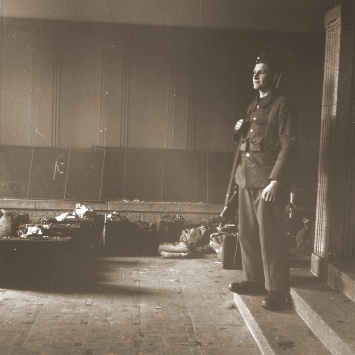 A Swiss military reservist guards the possessions of Jews rescued from Theresienstadt.