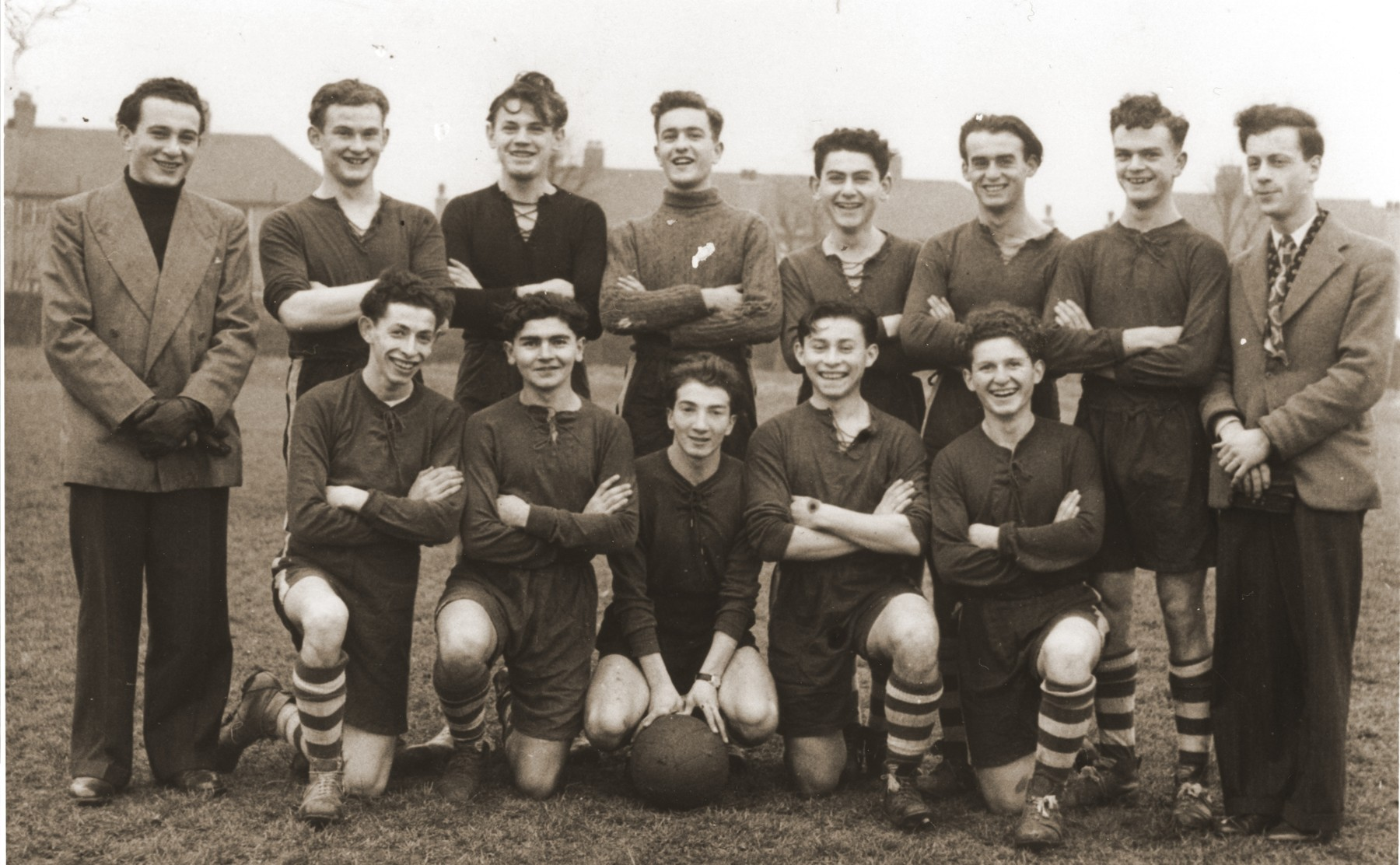 Group portrait of members of the Primrose Jewish Youth club soccer team on a sports field in London.  Pictured from left to right are: (first row) Willie Rosenberg, Abie Herman, Joseph Zelikovich, David Goldschild, Erwin Buncel (second row); Sam Weinberger,  Leopold Frischman, Samuel Oliner, Ullman, Alex Abrahamovitz, Sidney Farkas, and Ziggy ?.