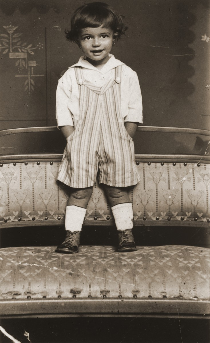 Studio portrait of Erika Vermes, a young Jewish child in Topolcany, Slovakia.