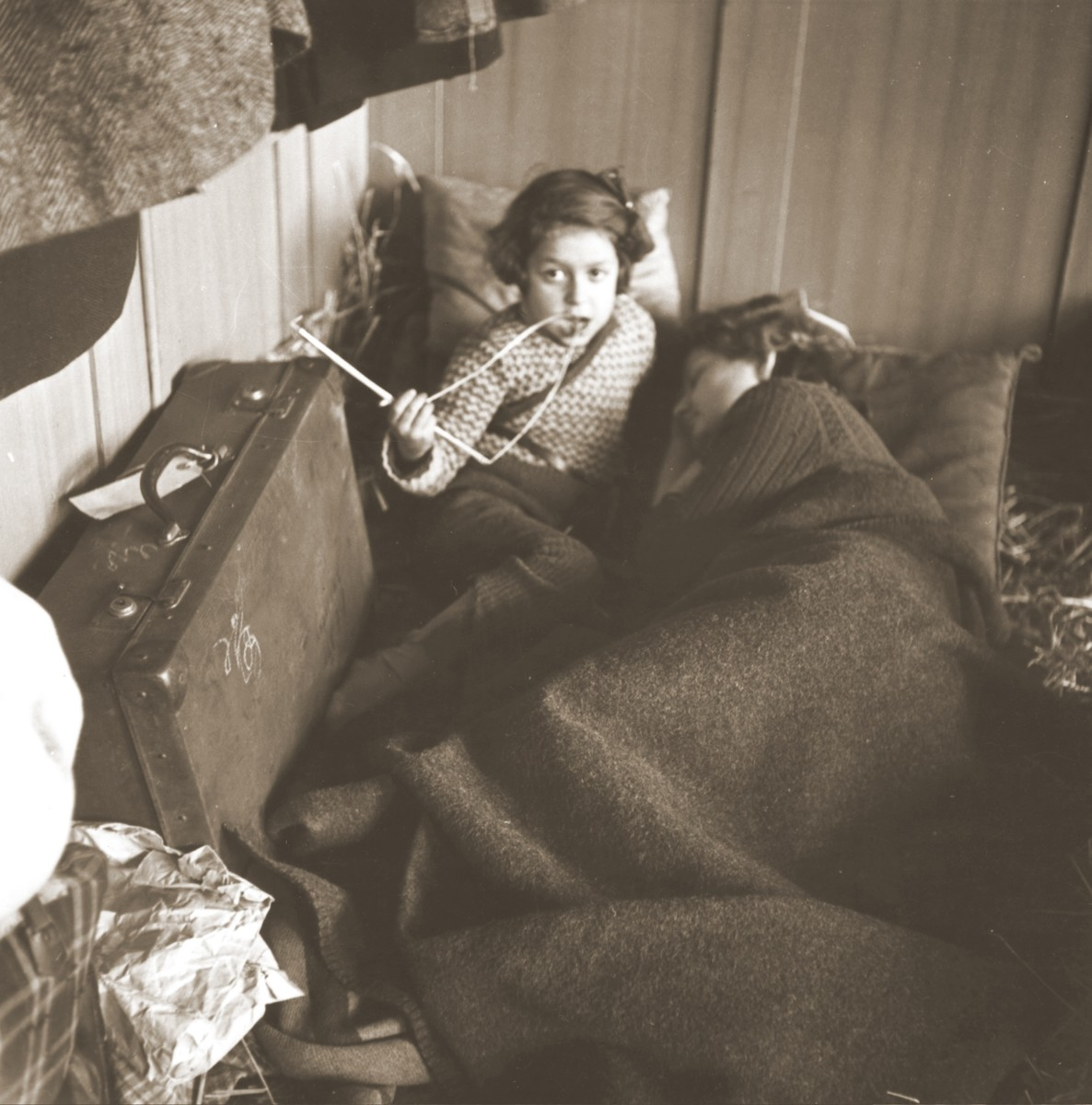 Jewish children rest on beds of straw in the Hadwigschulhaus in St, Gallen.
