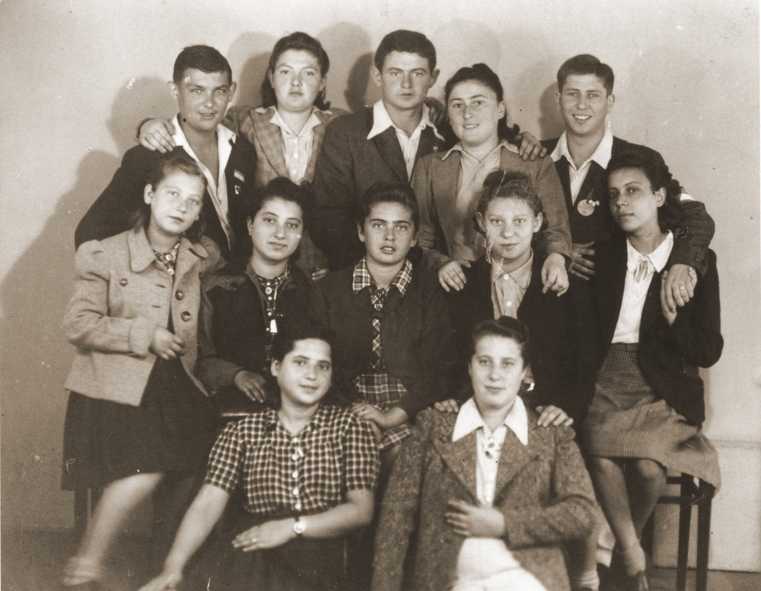 Group portrait of members of the orphans transport in Prague prior to their departure for England.  Among those pictured is Moniek Goldberg (top row, center).