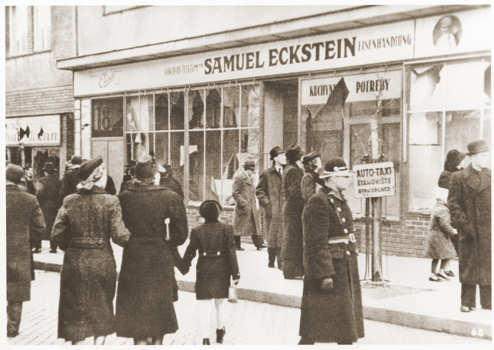 Pedestrians view the vandalized iron goods store owned by Samuel Eckstein.