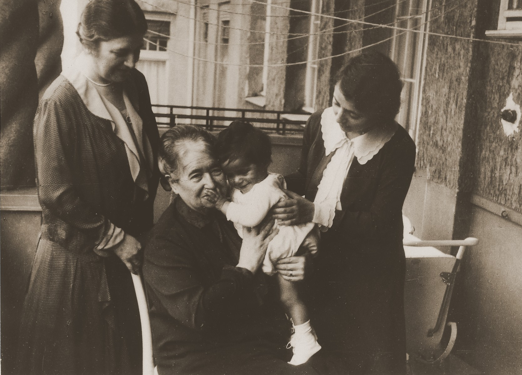 Uriel Michael Stein with his mother and grandmothers.  Pictured from left to right are:  Betty Kantarowitz (grandmother), Mrs. Stein (grandmother), Uriel Michael Stein and Ruth Stein.