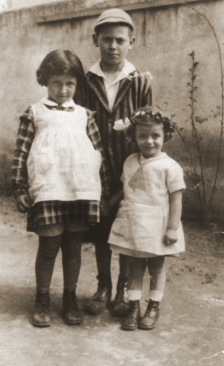 Three Jewish children in Topolcany, Slovakia.  Among those pictured are Robert Vermes (behind) and his sister Erika (right).