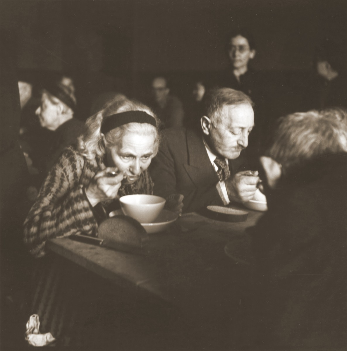 Elderly Jews rescued from Theresienstadt enjoy a warm meal in the Hadwigschulhaus in St. Gallen.