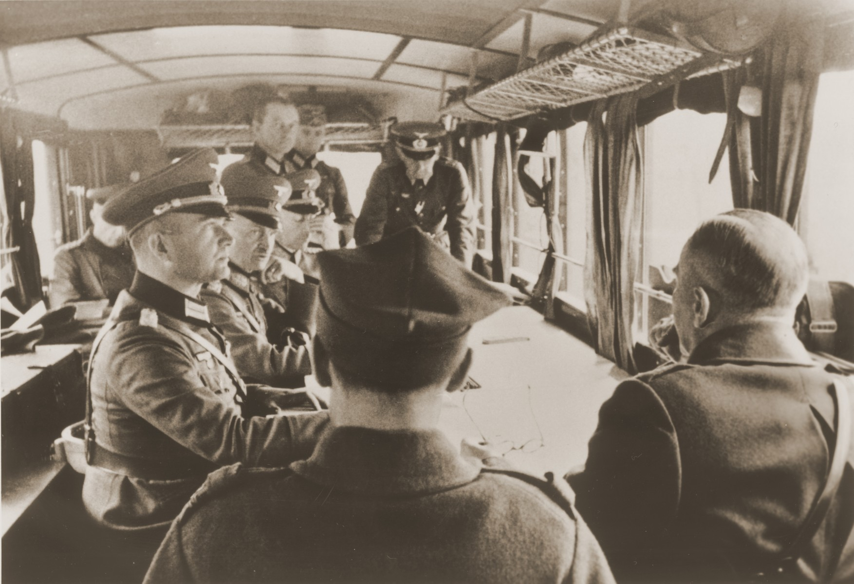 German General Blaskowitz (left, center of the table) presides over the official surrender of the Polish Army in a railway car at the Skoda Motor Works near Warsaw.