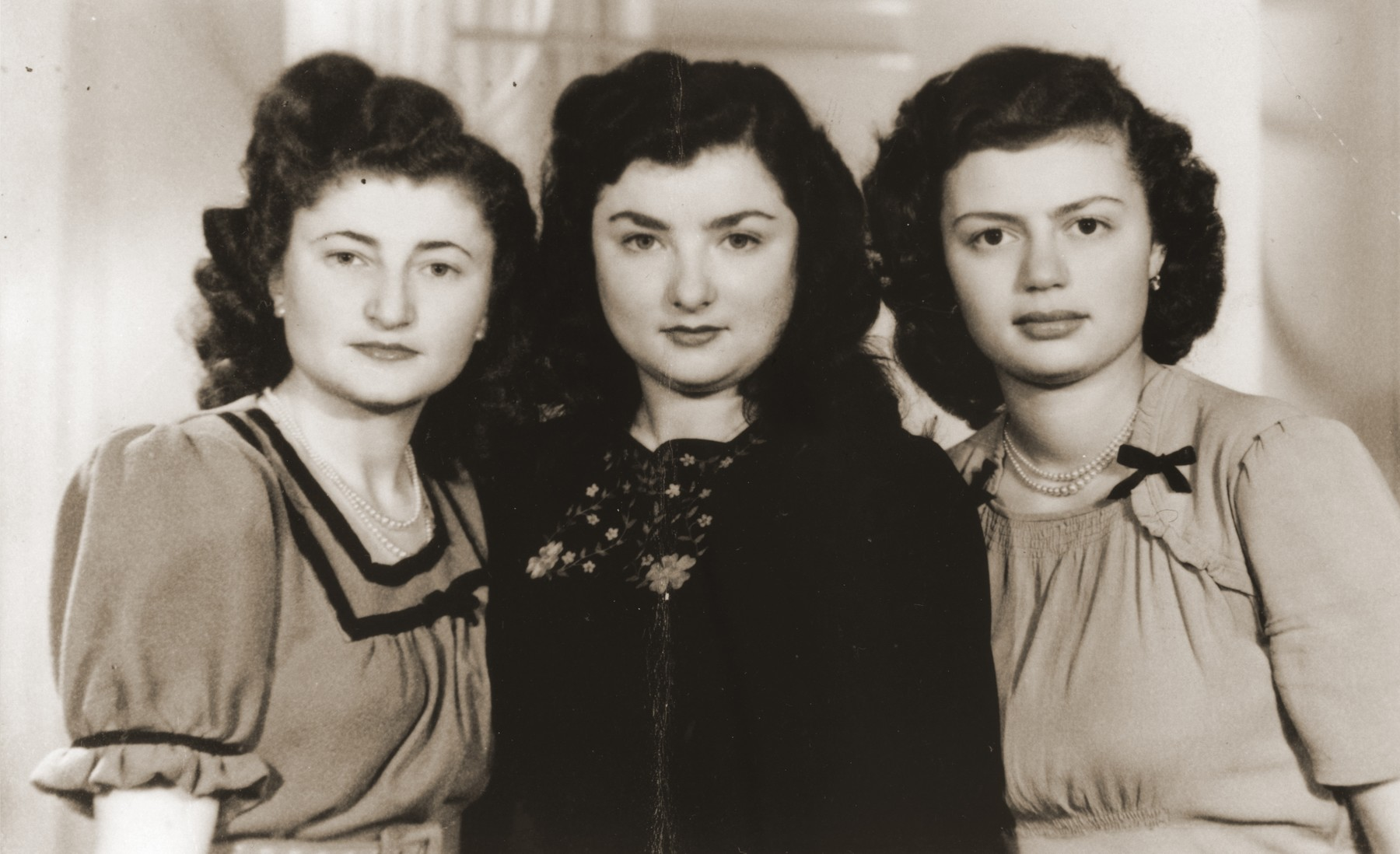 Portrait of three young Jewish women who were brought to England after the war on the orphans transport.  Pictured from left to right are Irene Mermelstein, Helen Slomowitz and Erika Vermes.
