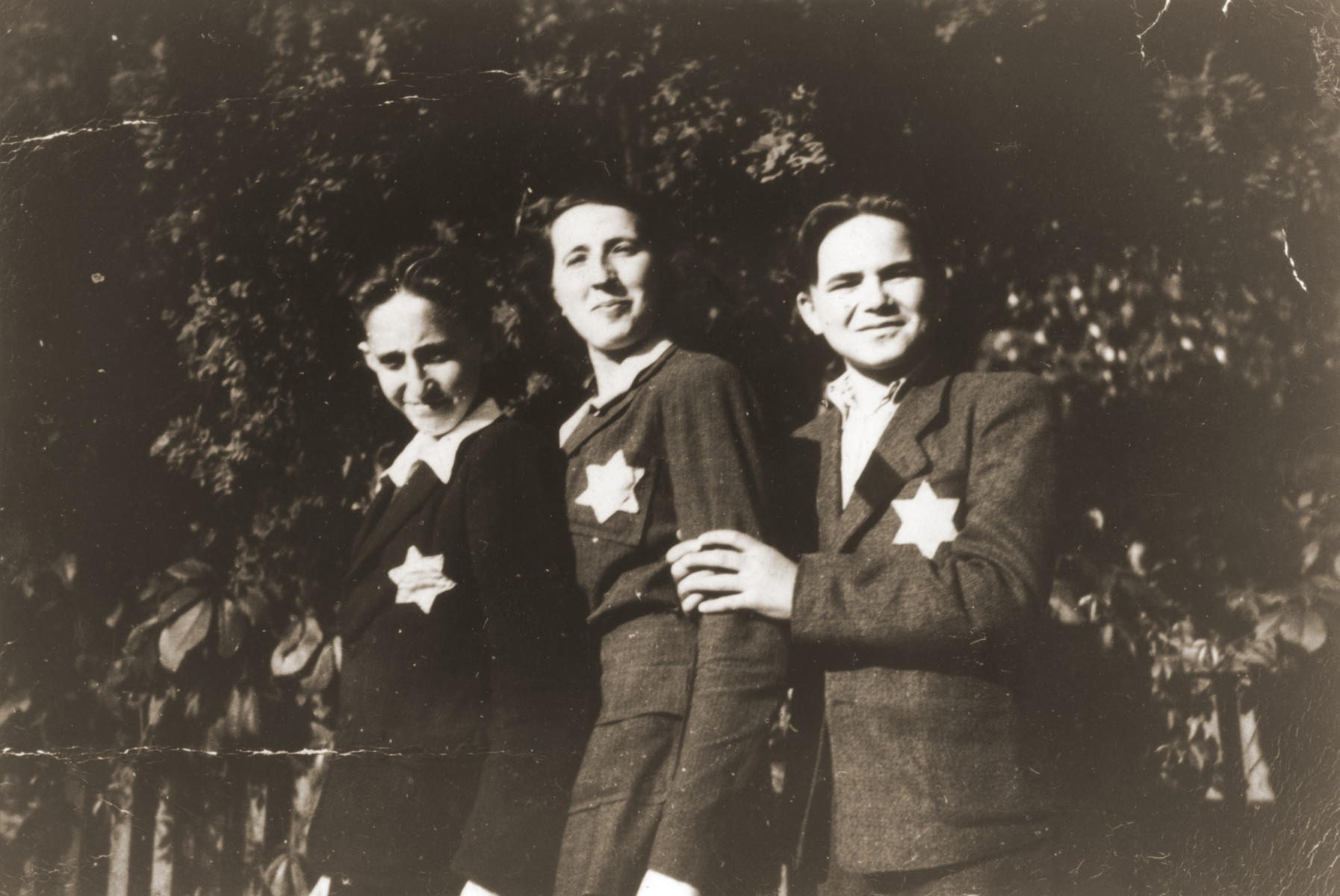 Maylech Blobstein (right) poses with his cousins, Chaya and Hershi Blobstein, wearing the yellow star.  Hershi was later killed in an Allied bombing raid on Hungary.