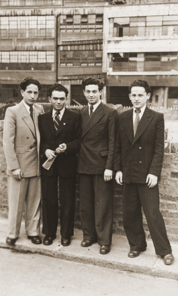 "Four members of the orphans transport to England known as ""The Boys"" pose on a city street.  Pictured from left to right are Moric Friedman, Leo Geddy, Martin Lampert and Joseph Grossman."