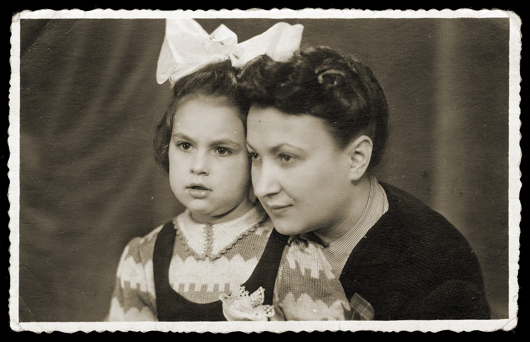 Studio portrait of a mother and daughter in the Bedzin ghetto.  Pictured is Dora Rembiszewska, with her four-year-old daughter, Mira.