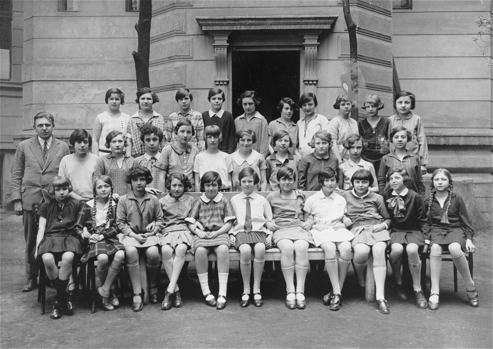 Group portrait of pupils at the Deutsches Madchen Reform Real Gymnasium Lyceum in Prague.  Among those pictured is Ruth Kohn (top row, fourth from the right).  The teacher is Professor Wyck.
