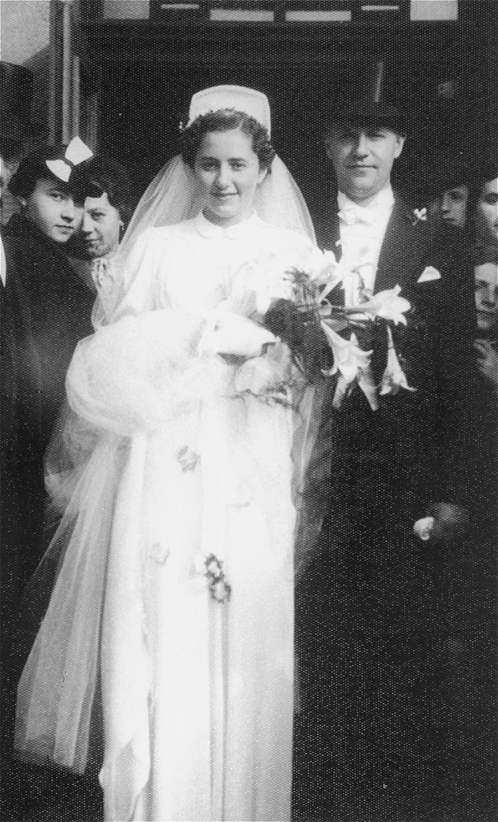 Wedding portrait of Dr. Laszlo Halmos and Katarina Kertesz, taken in front of the Neolog synagogue in Kosice, Slovakia.
