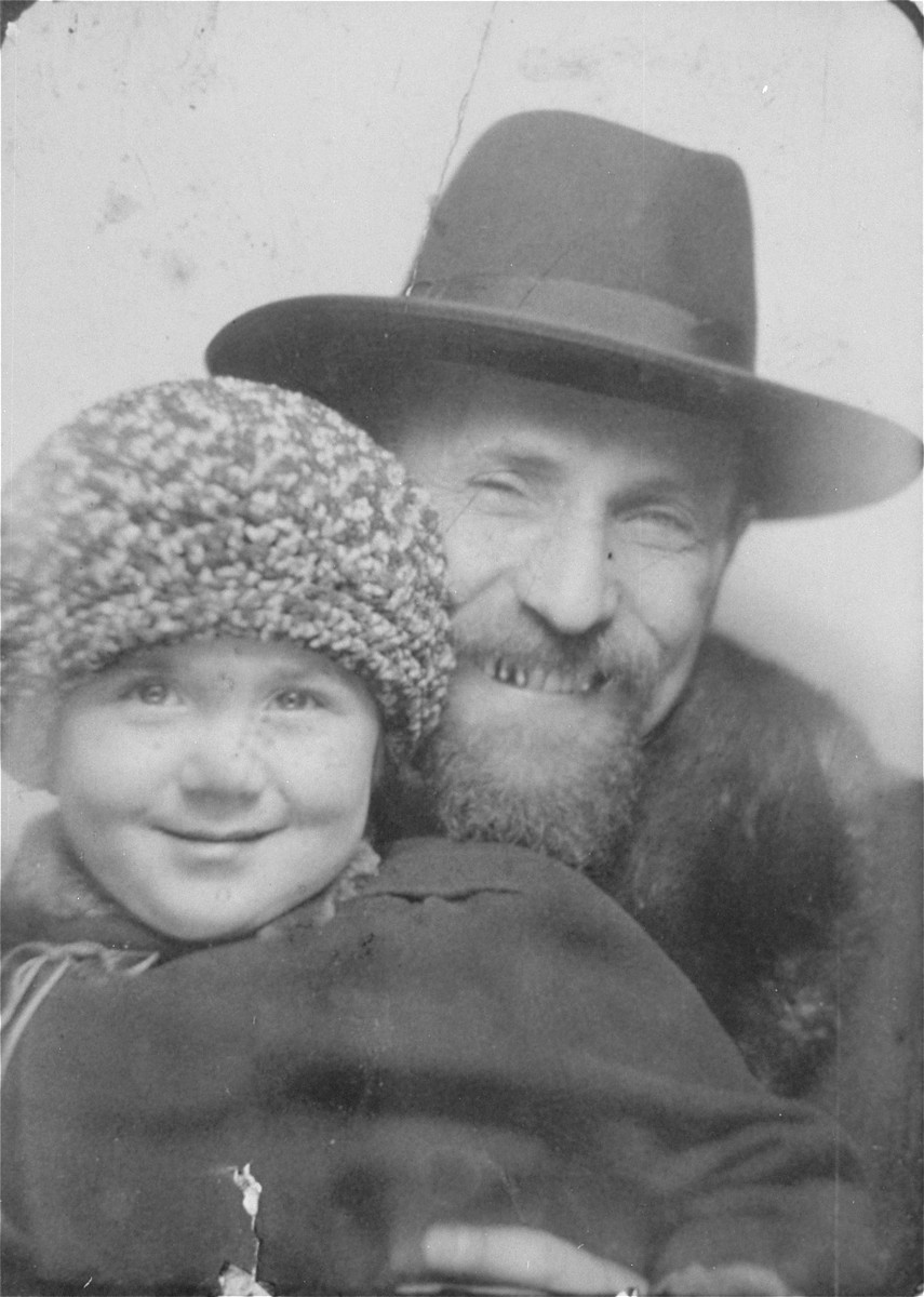 Close-up portrait of Samuel Liebermensch holding his young daughter, Ruth.