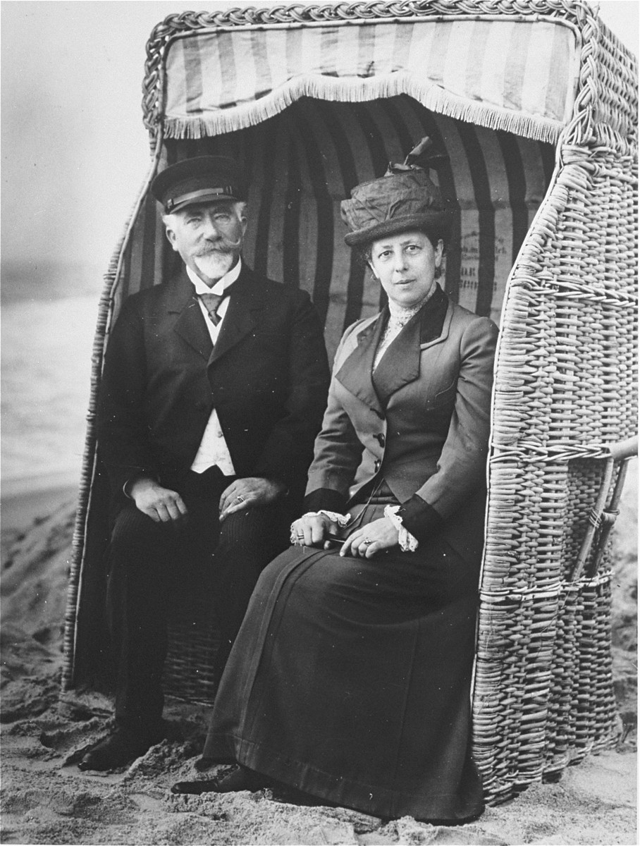 Siegfried and Rosa (Arnholz) Wolffberg sitting in a cabana on the beach in Westerland (on the island of Sylt in the North Sea).    Siegfried (1853-1933) was a physician.