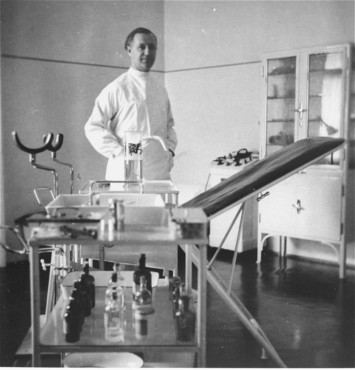The Jewish obstetrician, Dr. László Halmos, stands behind the examination table in his office on Vodna Street in Kosice.