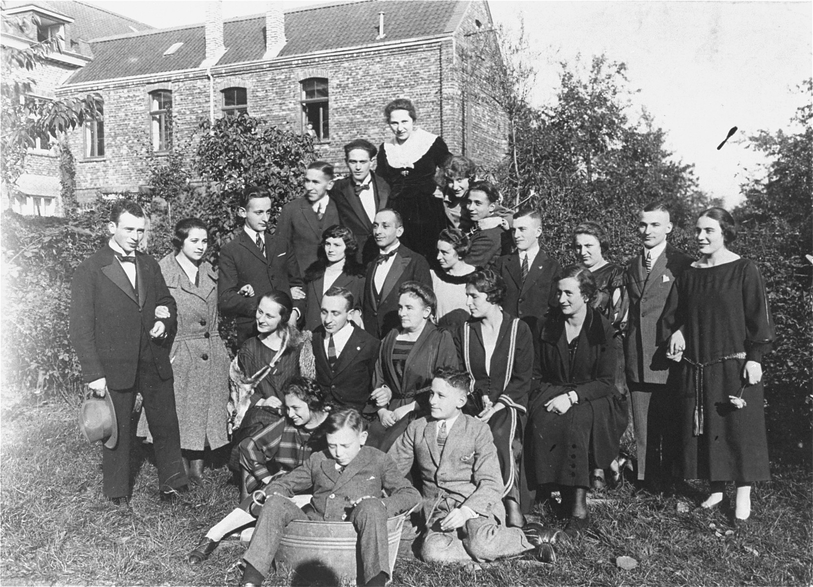 Group portrait of members of an extended Jewish family at a family gathering.    Pictured are members of the Hermans and Meyer families.  The only survivors of the two families were Henrietta and Sol Meyer, who emigrated to the U.S. in 1939 and settled in Rutland, Vermont.