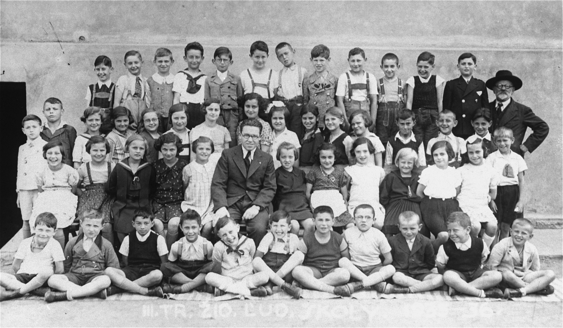 Arie Klein's third grade class at a Jewish elementary school.  The teacher, Shimon Goldberg,  survived the war and moved to Jerusalem.
