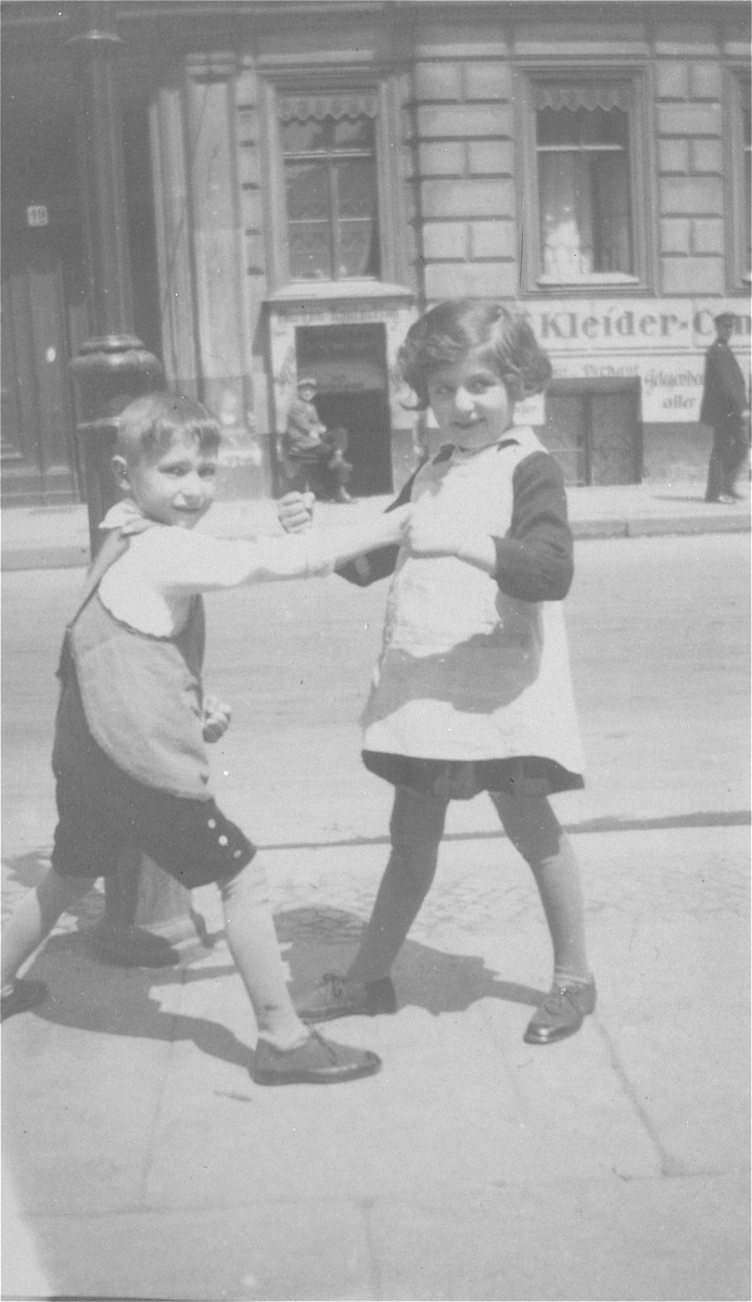 The twins, Leo and Celia Petranker, play outside on the sidewalk.   The twins are the children of Oscar Petranker.