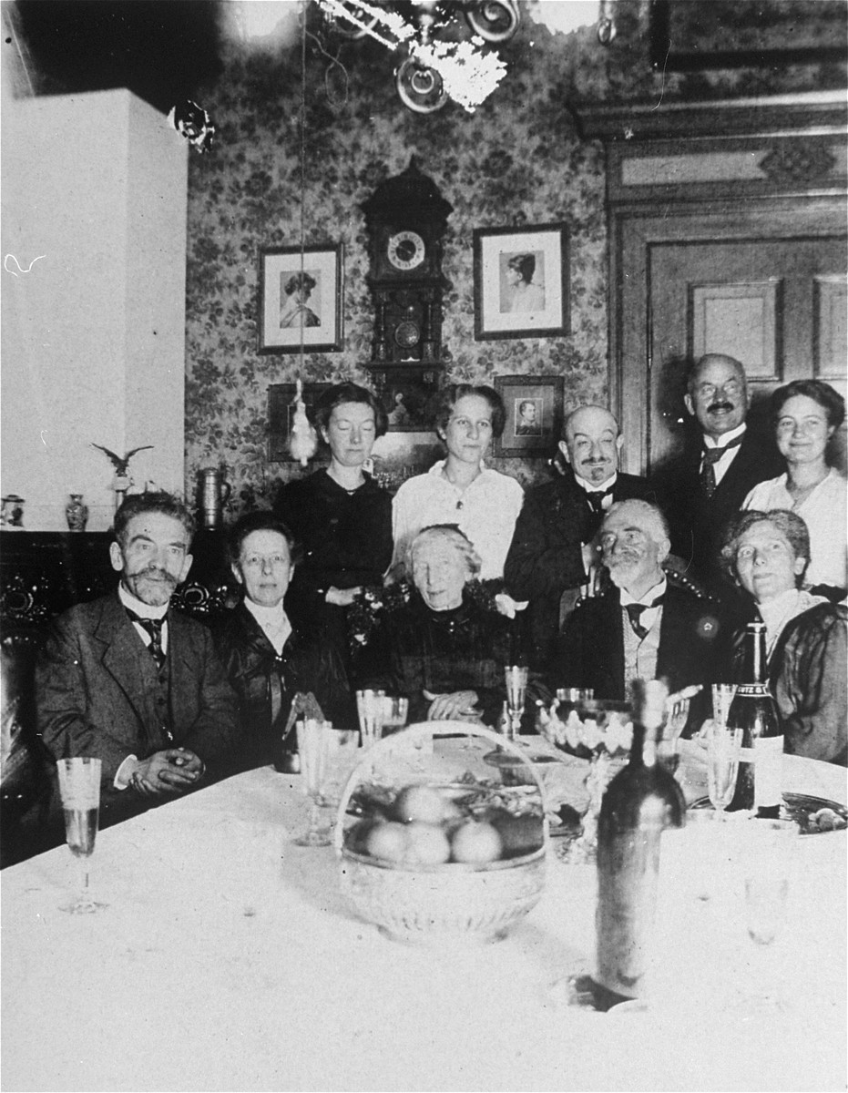Family celebration on the occasion of the birth of Guenther Knipfer, the son of Kaethe Knipfer, in Schlawe, Germany.   Pictured in the back row from left to right are: unknown friend, Kaethe Knipfer, Hugo Gottschalk, Max Knipfer and Nanny Lewin.  In the front row are: Siegfried and Rosa Wolffberg, Johanna and Eduard Wolffberg, and Bertha Gottschalk.