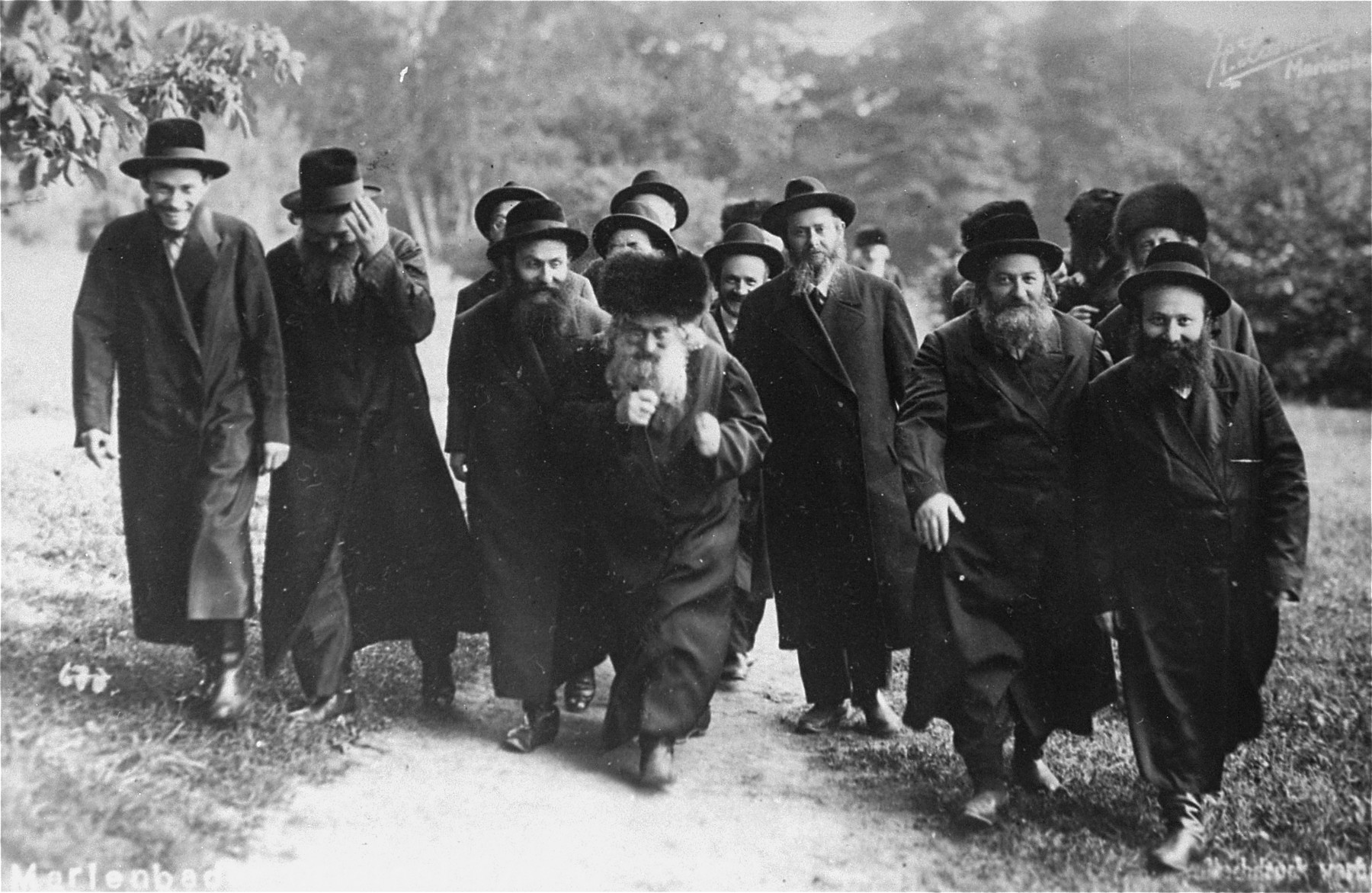 A Hasidic rabbi and his followers take the waters in Karlsbad.  In the center is Rabbi Avraham Mordechai Alter (the Gerer rebbe 1905-1948) and to his left is his son Rabbi Yisrael Alter and to his right are his other two sons Rabbi Mayer Alter and Rabbi Simcha Bina Alter.