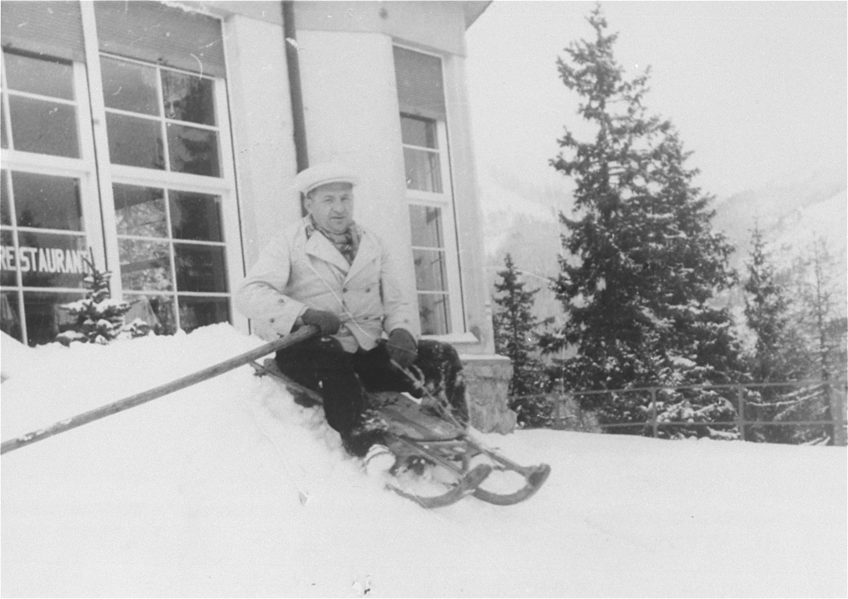 Portrait of Nandor Muller sledding at a winter resort in the Tatra mountains.