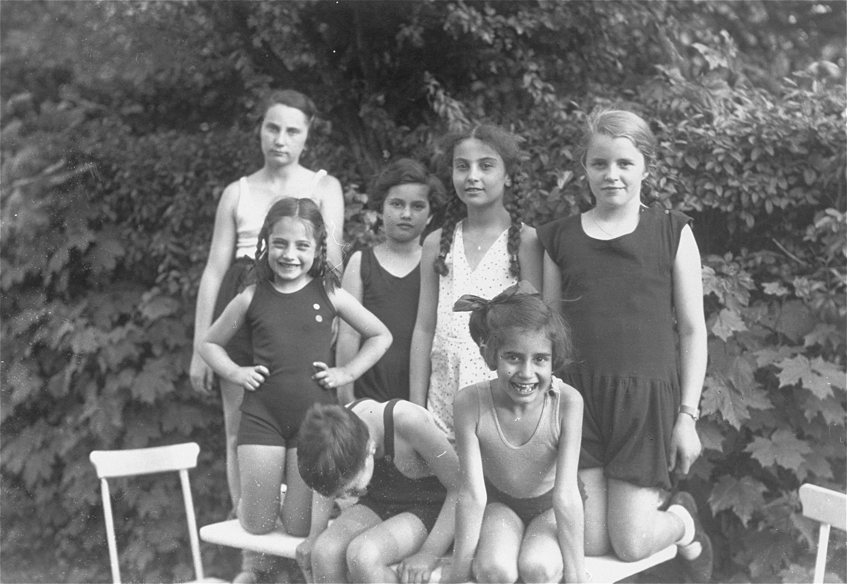 The children of Georg and Gertrude Anker pose with their friends and cousins in Berlin.   Among those pictured are Eva, Dodi and Hilde Anker and their cousin Else Karplus