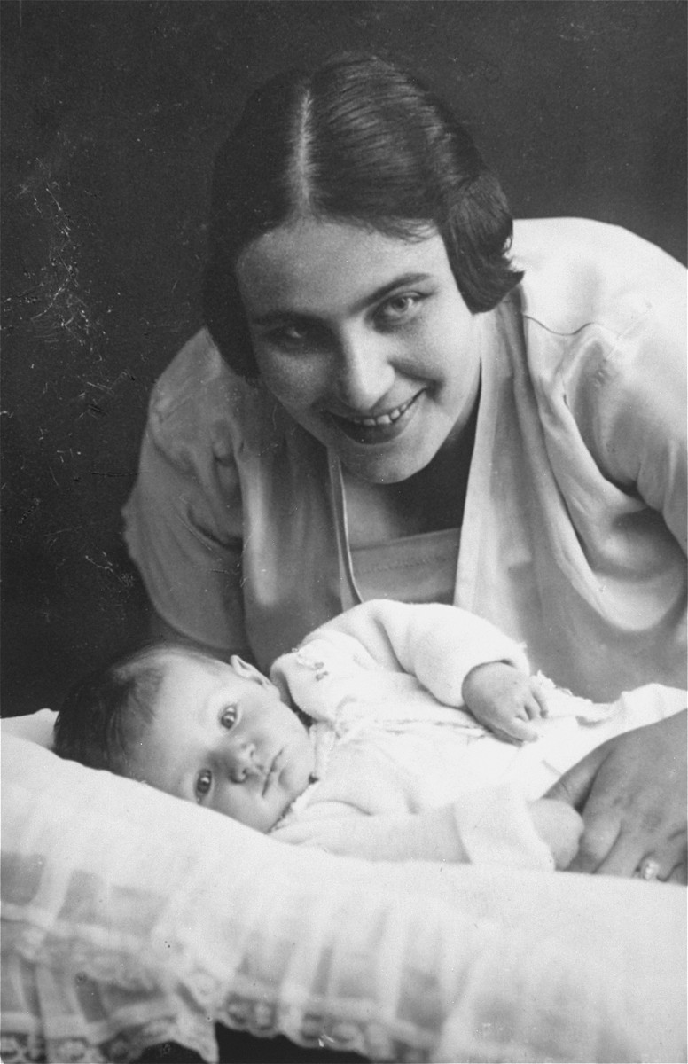 Portrait of a Jewish mother and son.  Pictured are Henrietta (Hermans) Meyer with her son, Harvey.  The family emigrated to the U.S. in 1939.