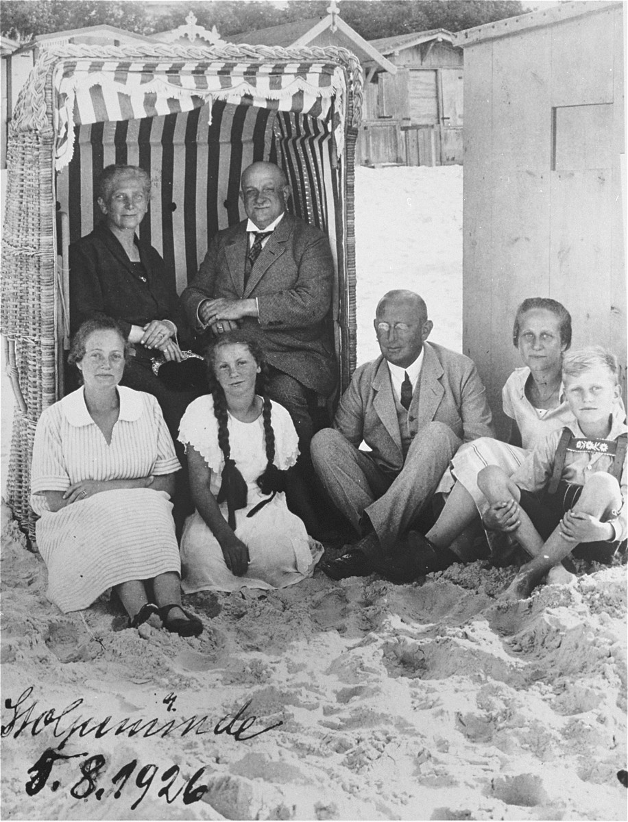 The Gottschalk family vacationing on a beach in Stolpmuende, Germany.  Pictured behind are Bertha and Hugo Gottschalk.  Seated in front (from left to right) are: Nanny Gottschalk; her daughter, Ursula Lewin; Max Knipfer; his wife, Kaethe, and their son, Guenther.