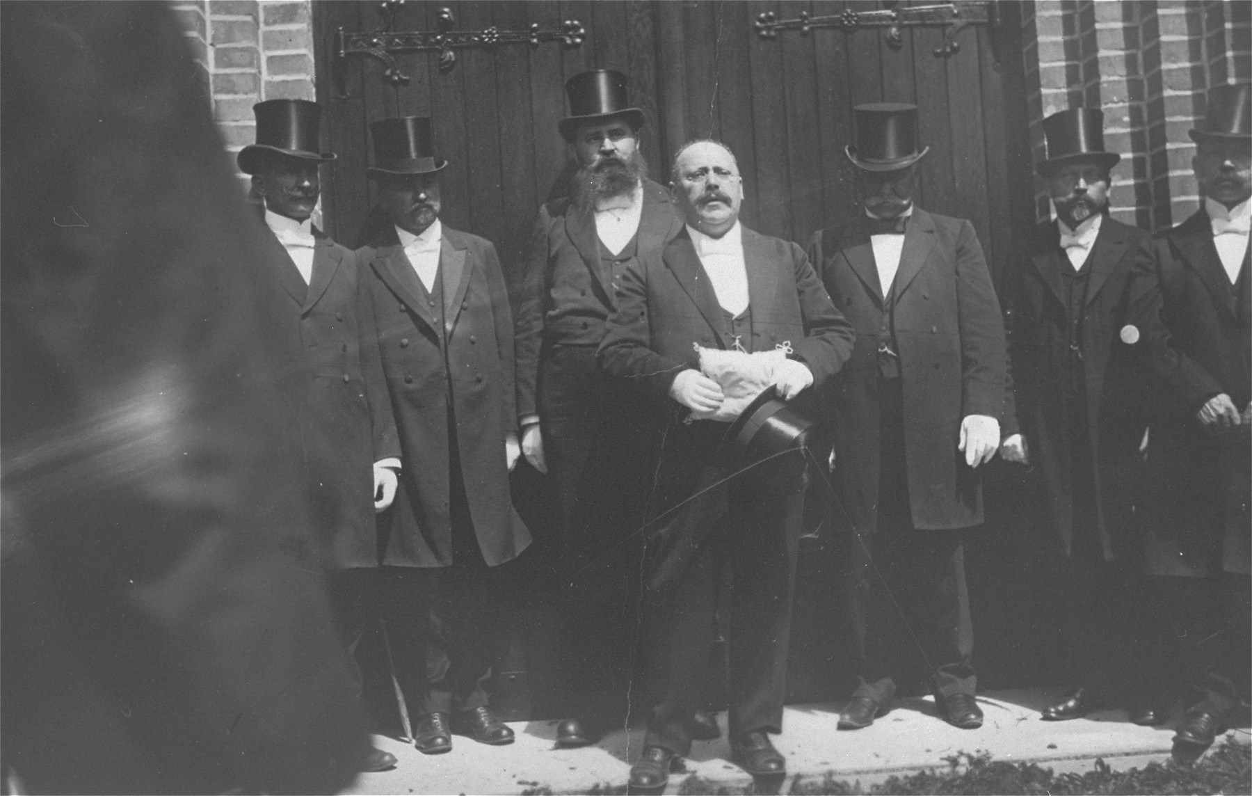 Prominent Jews dressed in top hats attend the dedication of the synagogue in Rastenburg, East Prussia.  Speaking is Max Jaruslawsky (the great-great uncle of the donor, George Fogelman).