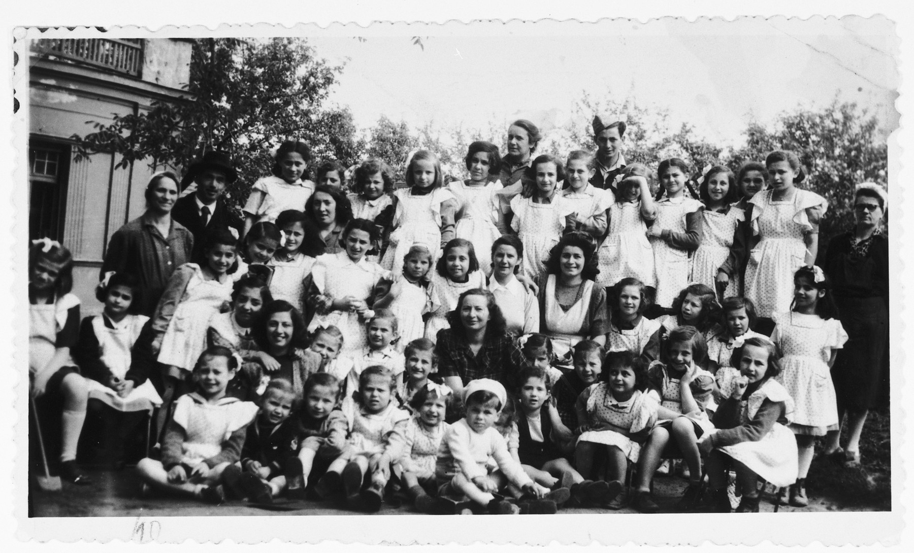 Zsofi Brunn (back row, center) poses with the orphans under her care in a JDC sponsored orphanage outside of Budapest.  Zsofi Brunn directed this orphanage from 1946 to 1948.  The children were retrieved from hiding from the JDC, and Zsofi worked with the Zionist underground to bring the children to Israel.  In 1948 an informant told the governmnet about her activities, and she had to flee to Germany.